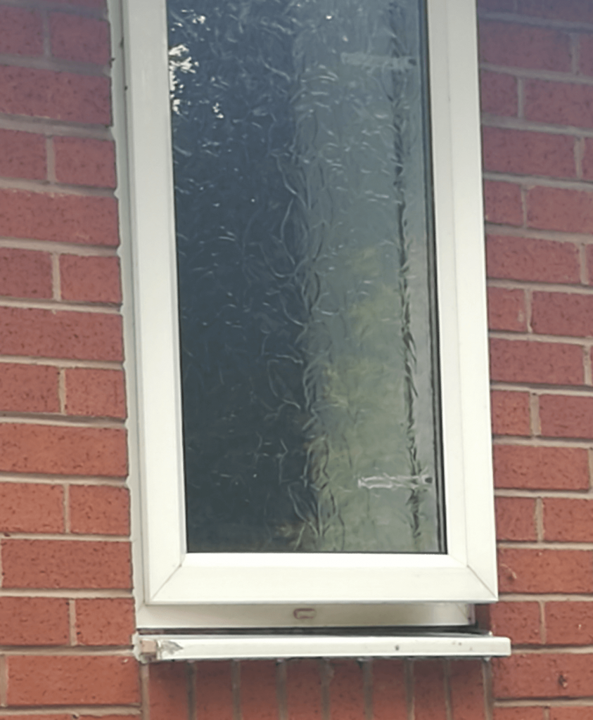 R n B Window Cleaning - The Same Window After We Cleaned It.